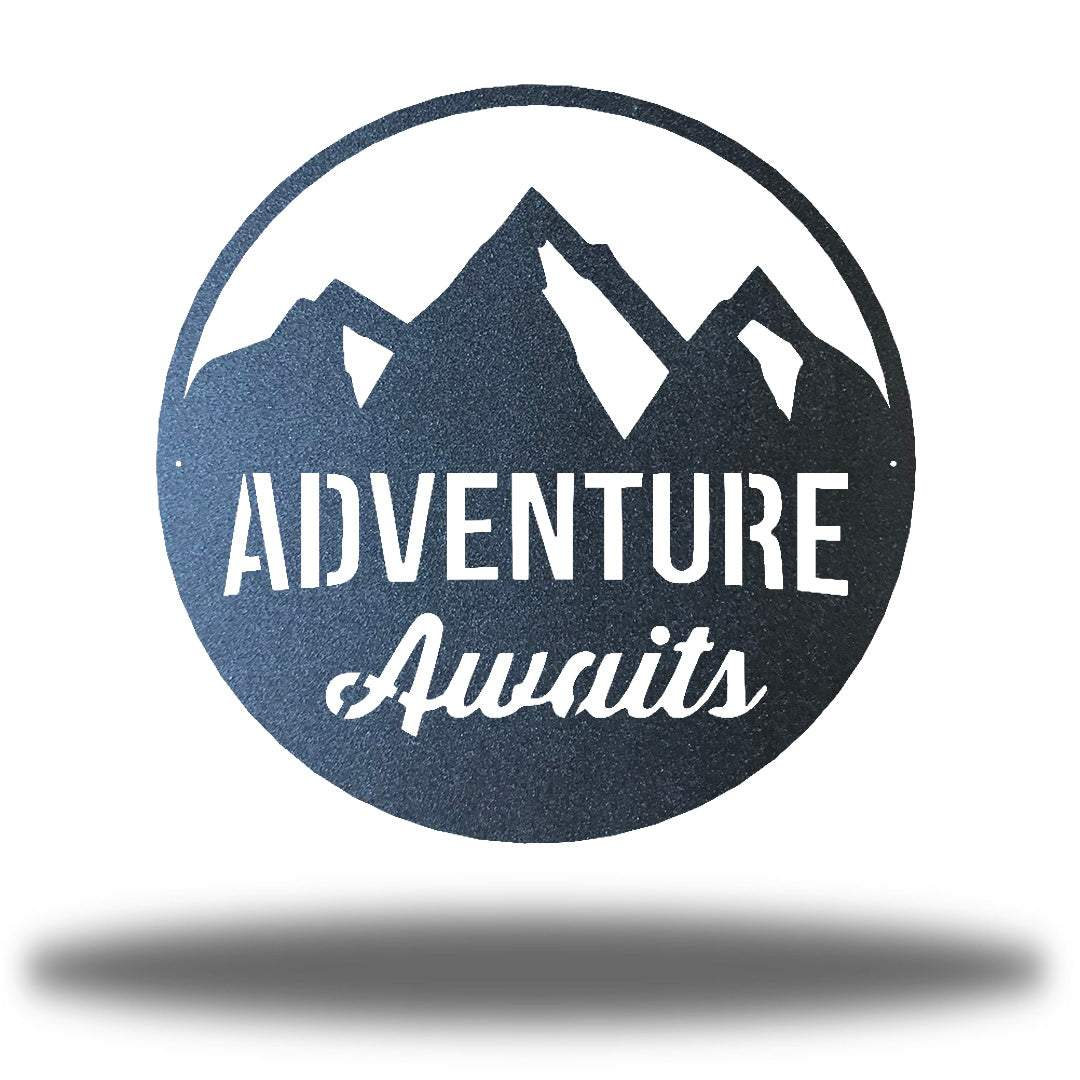 "Black steel decorative signage with mountain designs and the text ""ADVENTURE Awaits"" laser cut through it"