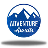 "Blue steel decorative signage with mountain designs and the text ""ADVENTURE Awaits"" laser cut through it"