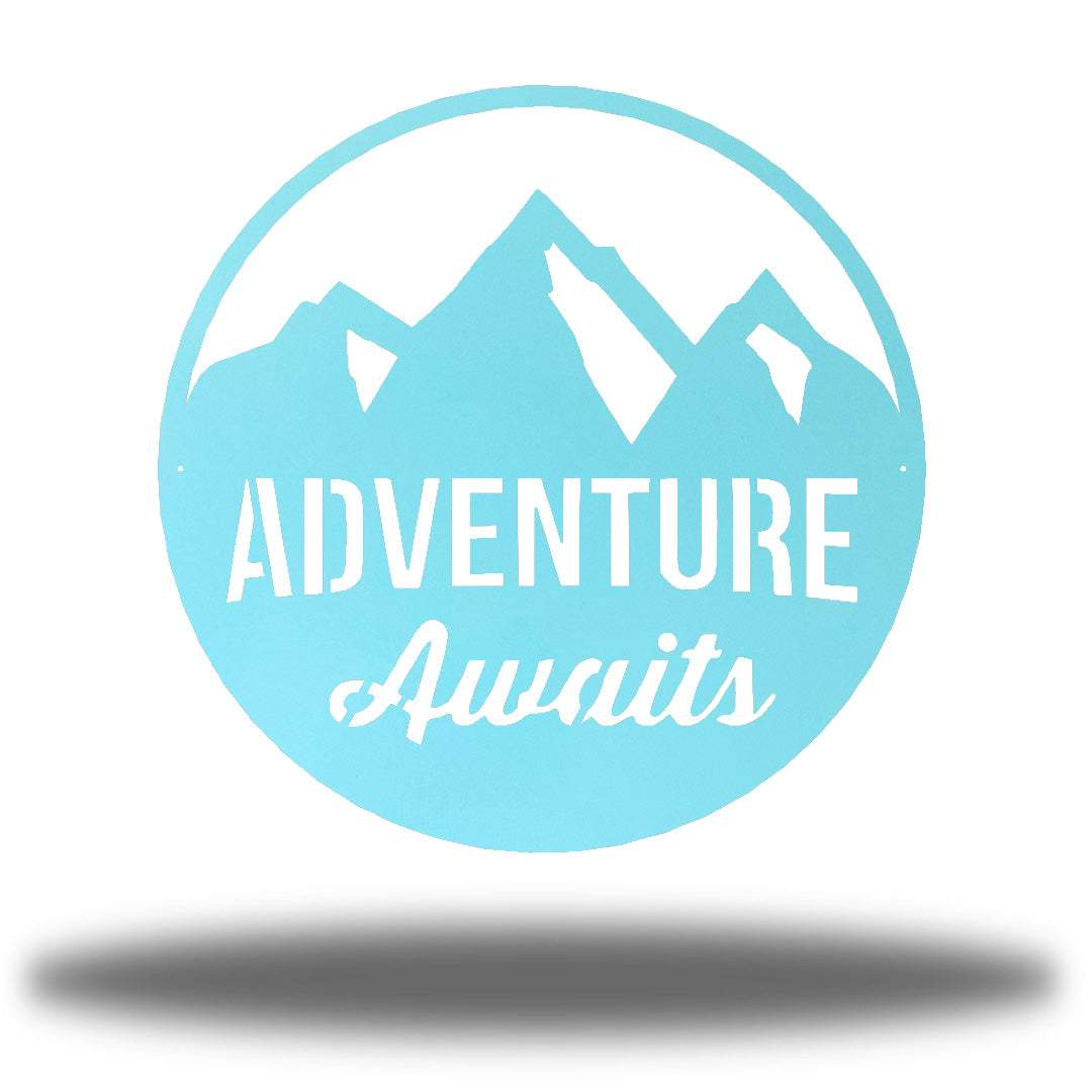 "Light blue steel decorative signage with mountain designs and the text ""ADVENTURE Awaits"" laser cut through it"