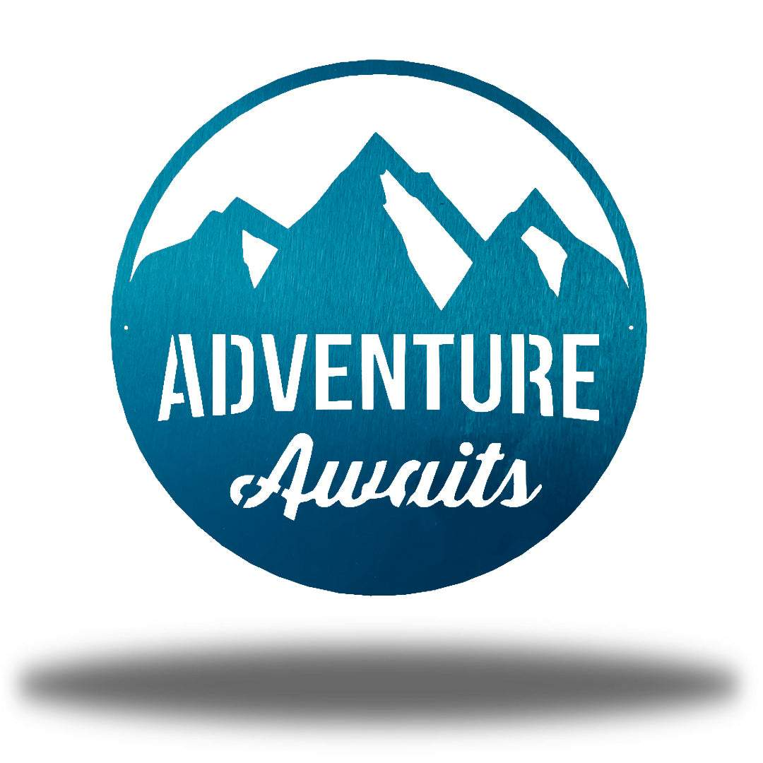 "Teal steel decorative signage with mountain designs and the text ""ADVENTURE Awaits"" laser cut through it"