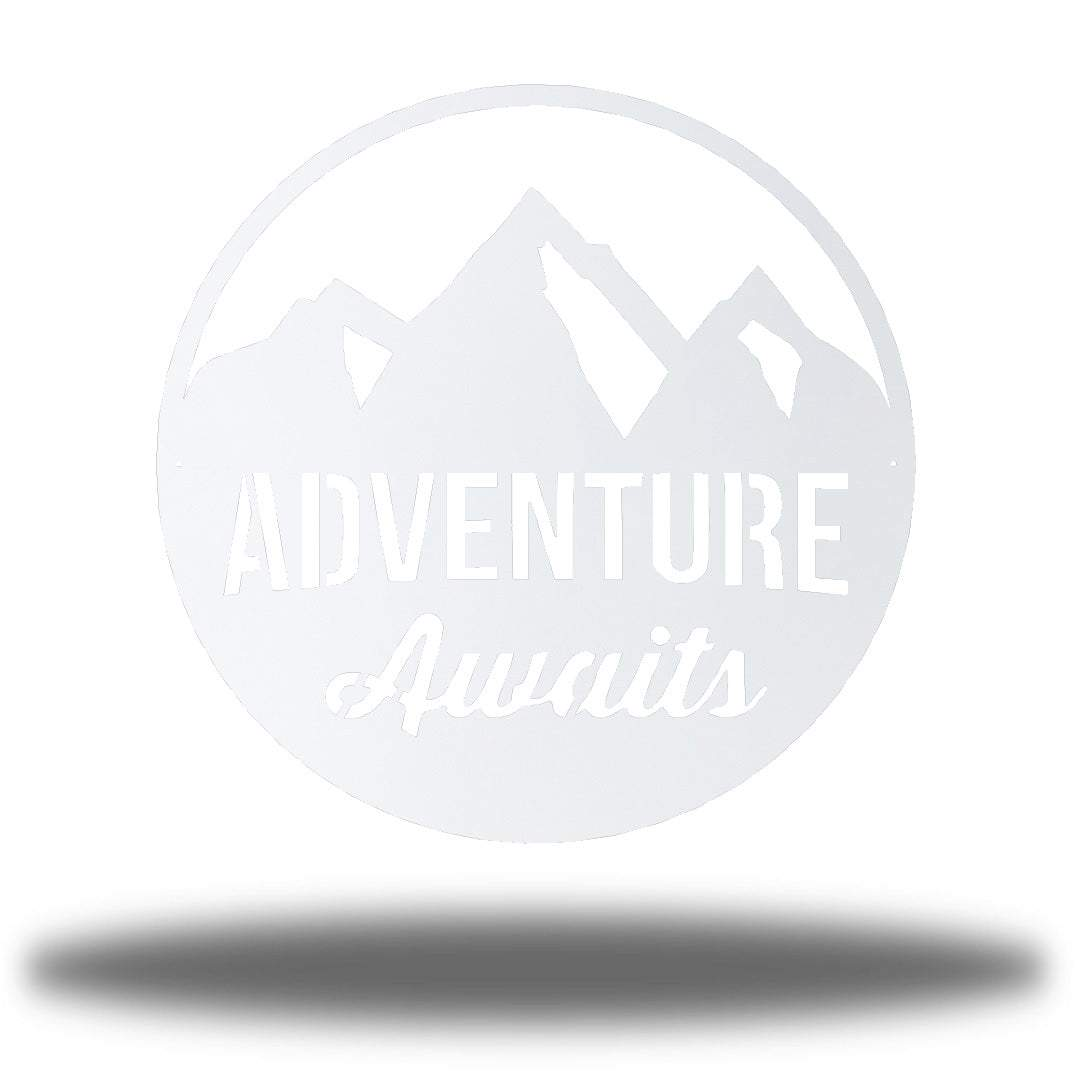 "White steel decorative signage with mountain designs and the text ""ADVENTURE Awaits"" laser cut through it"