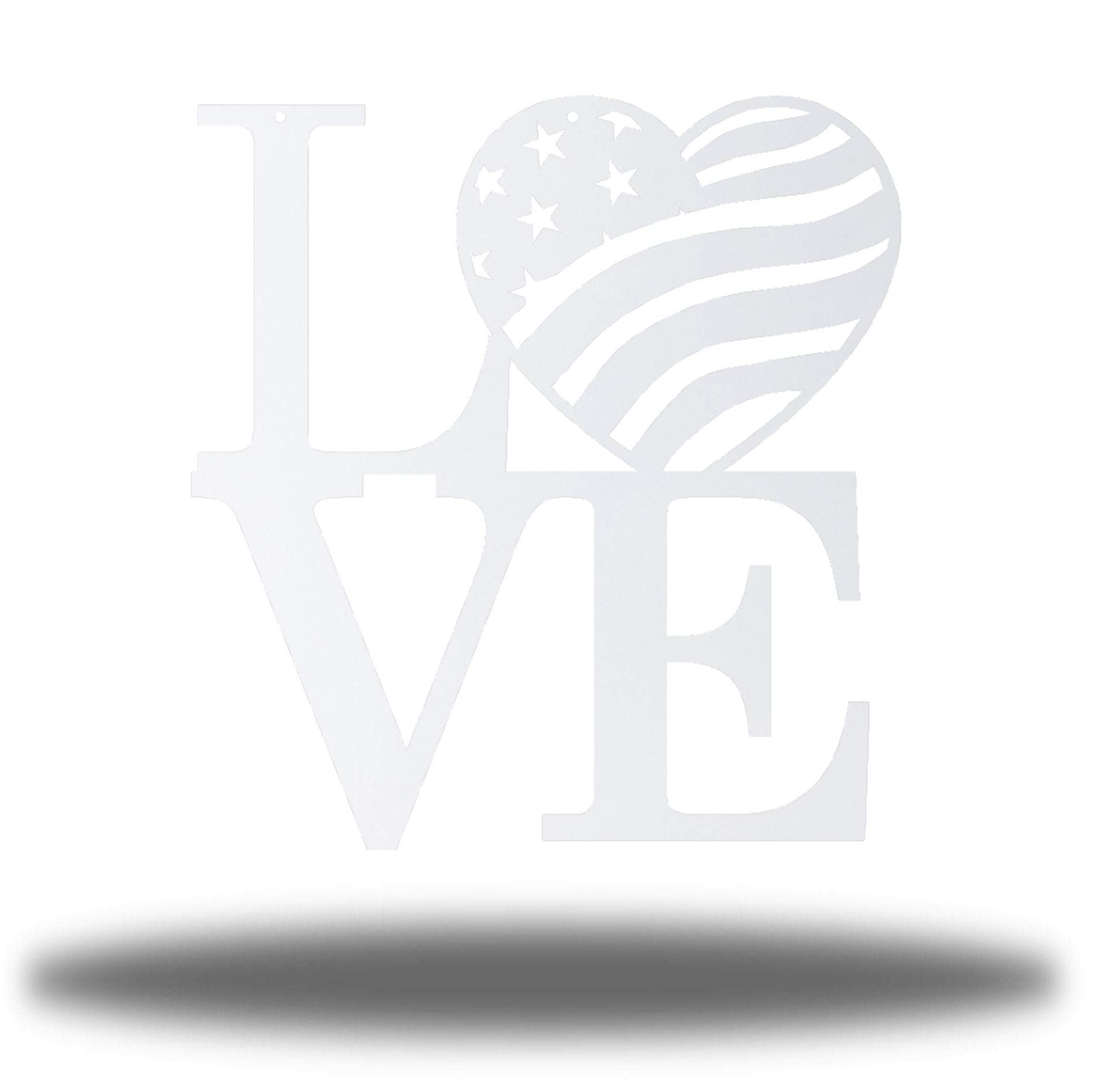 "White steel decorative sign that spells ""LOVE"" where 'O' is a heart-shaped USA flag"