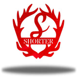"Red antler-shaped steel decorative monogram with the initial ""S"" in the middle and the word ""SHORTER"" below it."