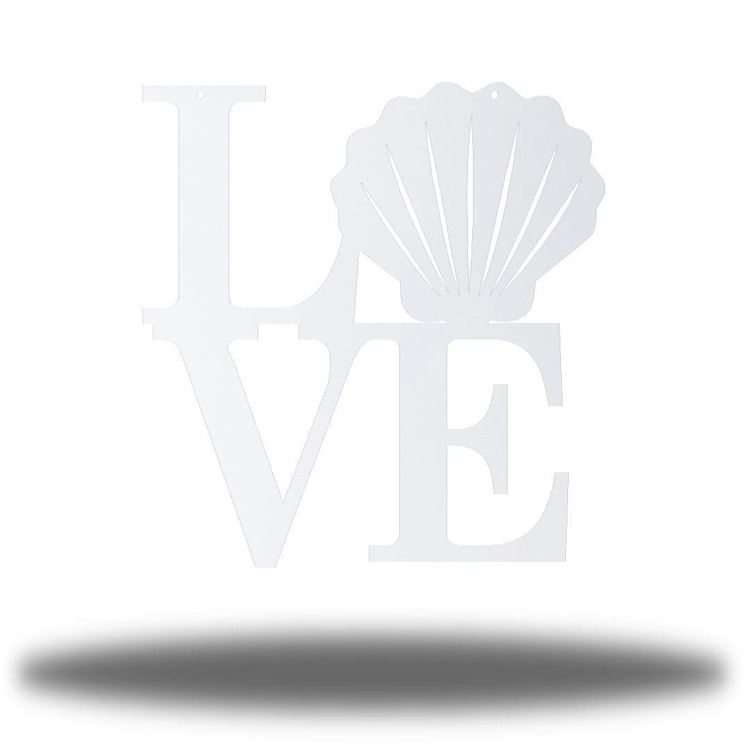 "White steel decorative sign that spells ""LOVE"" where 'O' is a clam shell"