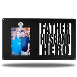 "Black decorative picture board sign with a photo of a man and an older man along with the texts ""FATHER, HUSBAND, HERO"""
