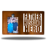 "Copper decorative picture board sign with a photo of a man and an older man along with the texts ""FATHER, HUSBAND, HERO"""