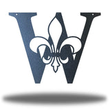 "Black letter ""W"" wall decoration with a fleur de lis symbol in the middle"
