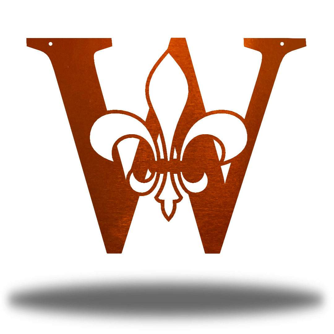 "Copper letter ""W"" wall decoration with a fleur de lis symbol in the middle"