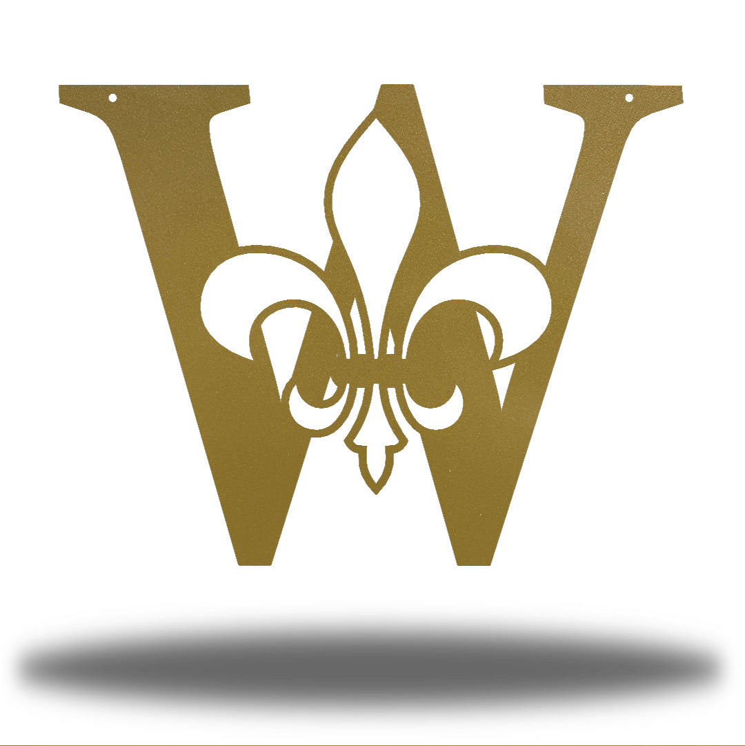 "Gold letter ""W"" wall decoration with a fleur de lis symbol in the middle"