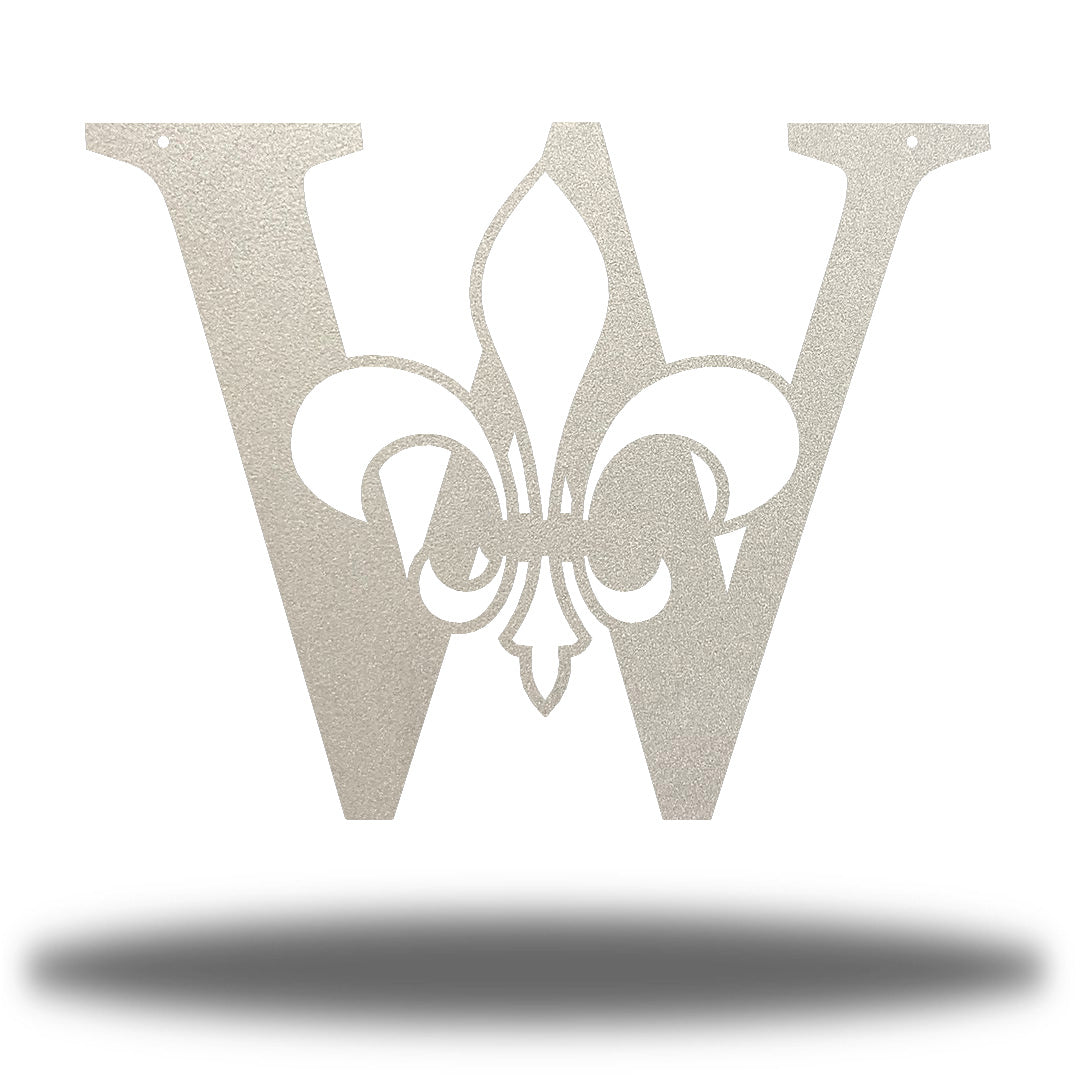 "Silver letter ""W"" wall decoration with a fleur de lis symbol in the middle"