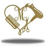 "Gold heart-shaped steel monogram featuring comb, blower, scissors and the initial ""M"""