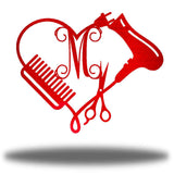 "Red heart-shaped steel monogram featuring comb, blower, scissors and the initial ""M"""