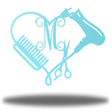 "Light blue heart-shaped steel monogram featuring comb, blower, scissors and the initial ""M"""