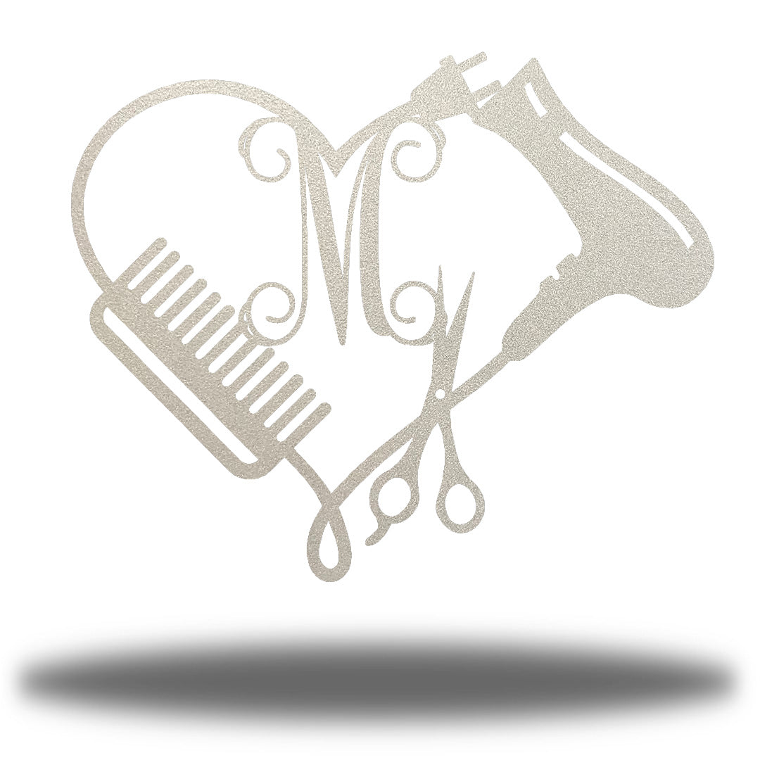 "Silver heart-shaped steel monogram featuring comb, blower, scissors and the initial ""M"""