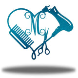 "Teal heart-shaped steel monogram featuring comb, blower, scissors and the initial ""M"""