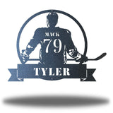 "Black steel wall art decoration featuring a hockey player with the texts ""MACK 79 TYLER"""