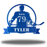 "Blue steel wall art decoration featuring a hockey player with the texts ""MACK 79 TYLER"""