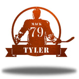 "Copper steel wall art decoration featuring a hockey player with the texts ""MACK 79 TYLER"""