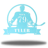 "Light blue steel wall art decoration featuring a hockey player with the texts ""MACK 79 TYLER"""