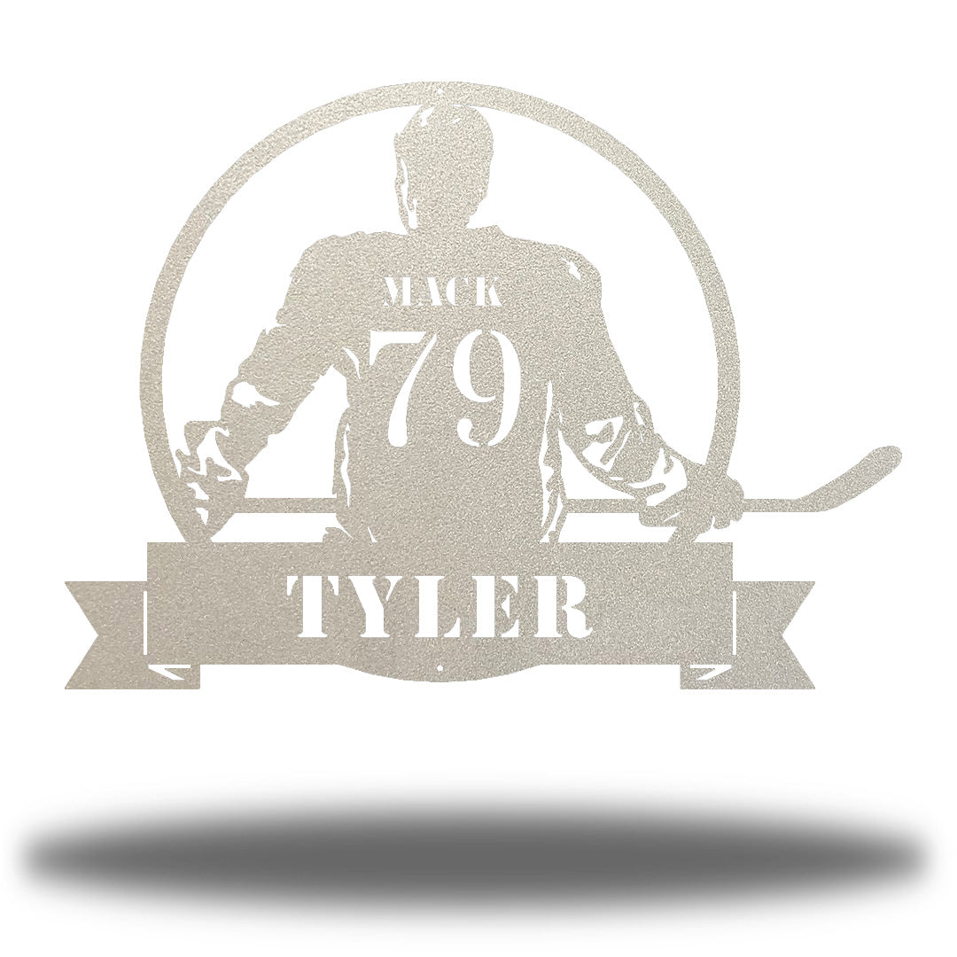"Silver steel wall art decoration featuring a hockey player with the texts ""MACK 79 TYLER"""
