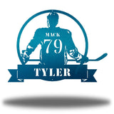 "Teal steel wall art decoration featuring a hockey player with the texts ""MACK 79 TYLER"""