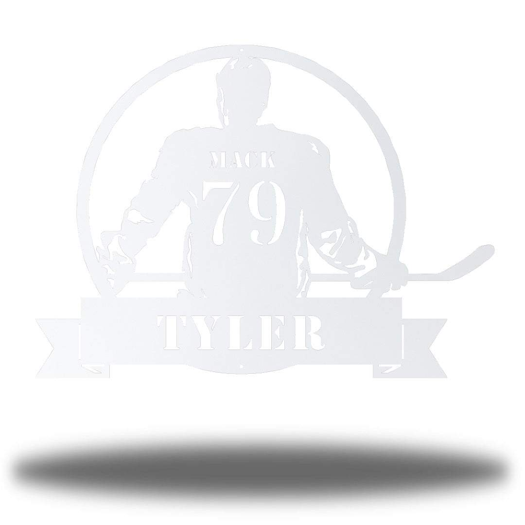 "White steel wall art decoration featuring a hockey player with the texts ""MACK 79 TYLER"""