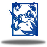 Blue steel wall art decoration that features a hummingbird feeding on flowers design