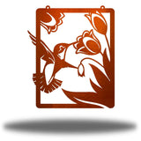 Copper steel wall art decoration that features a hummingbird feeding on flowers design