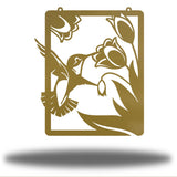 Gold steel wall art decoration that features a hummingbird feeding on flowers design