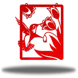 Red steel wall art decoration that features a hummingbird feeding on flowers design