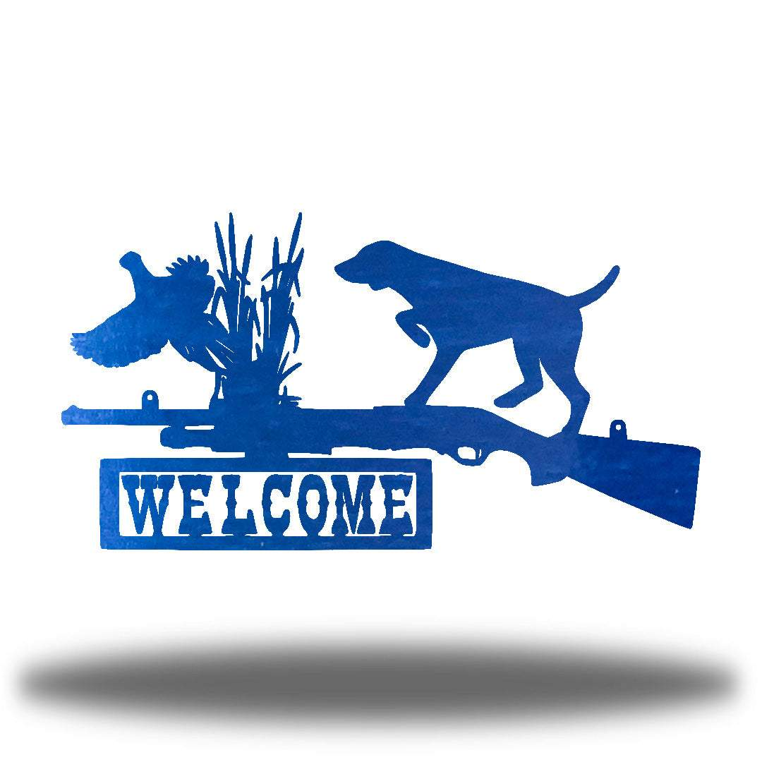 "Blue steel wall art decoration that features a dog, duck and shotgun with the word ""WELCOME"" on it"