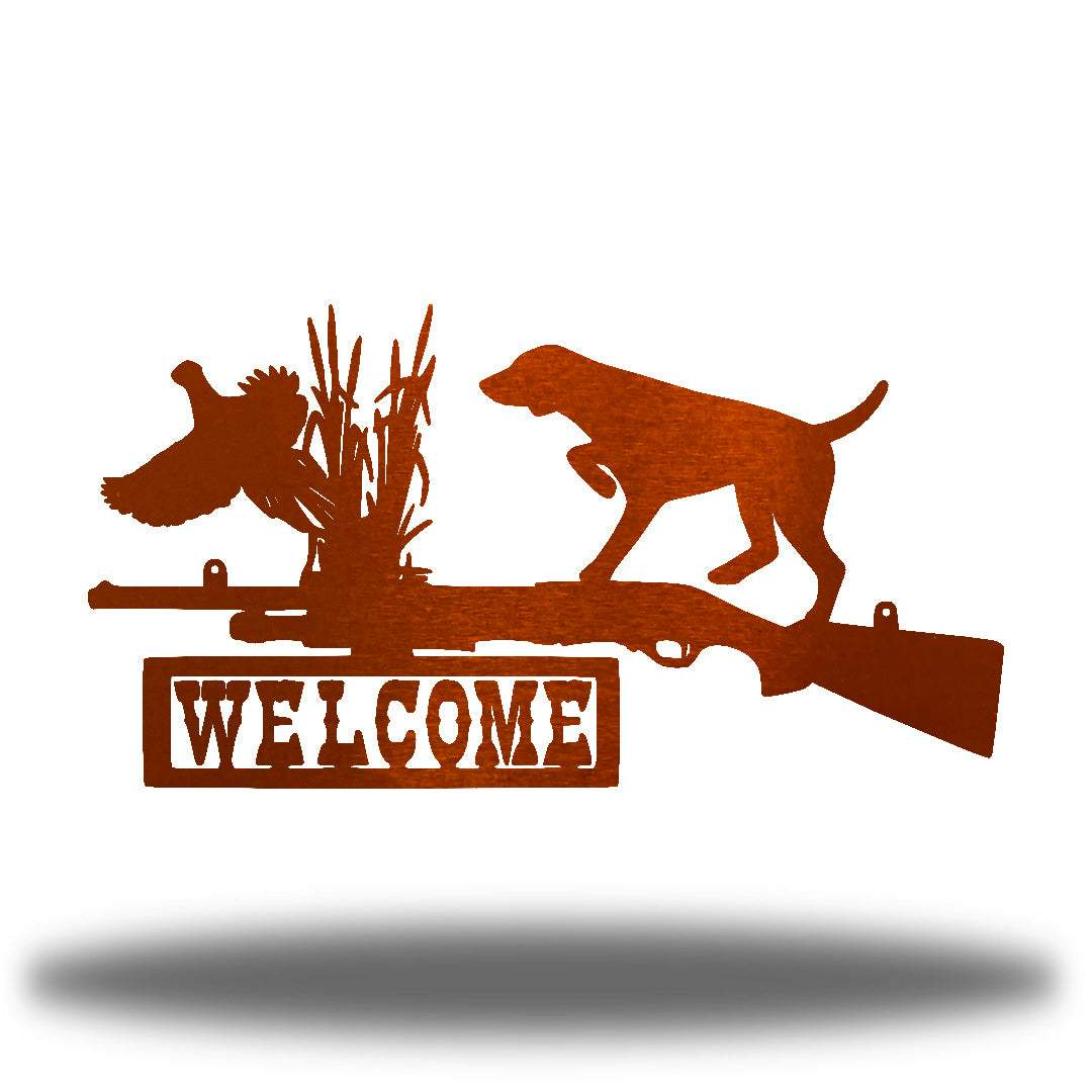 "Copper steel wall art decoration that features a dog, duck and shotgun with the word ""WELCOME"" on it"