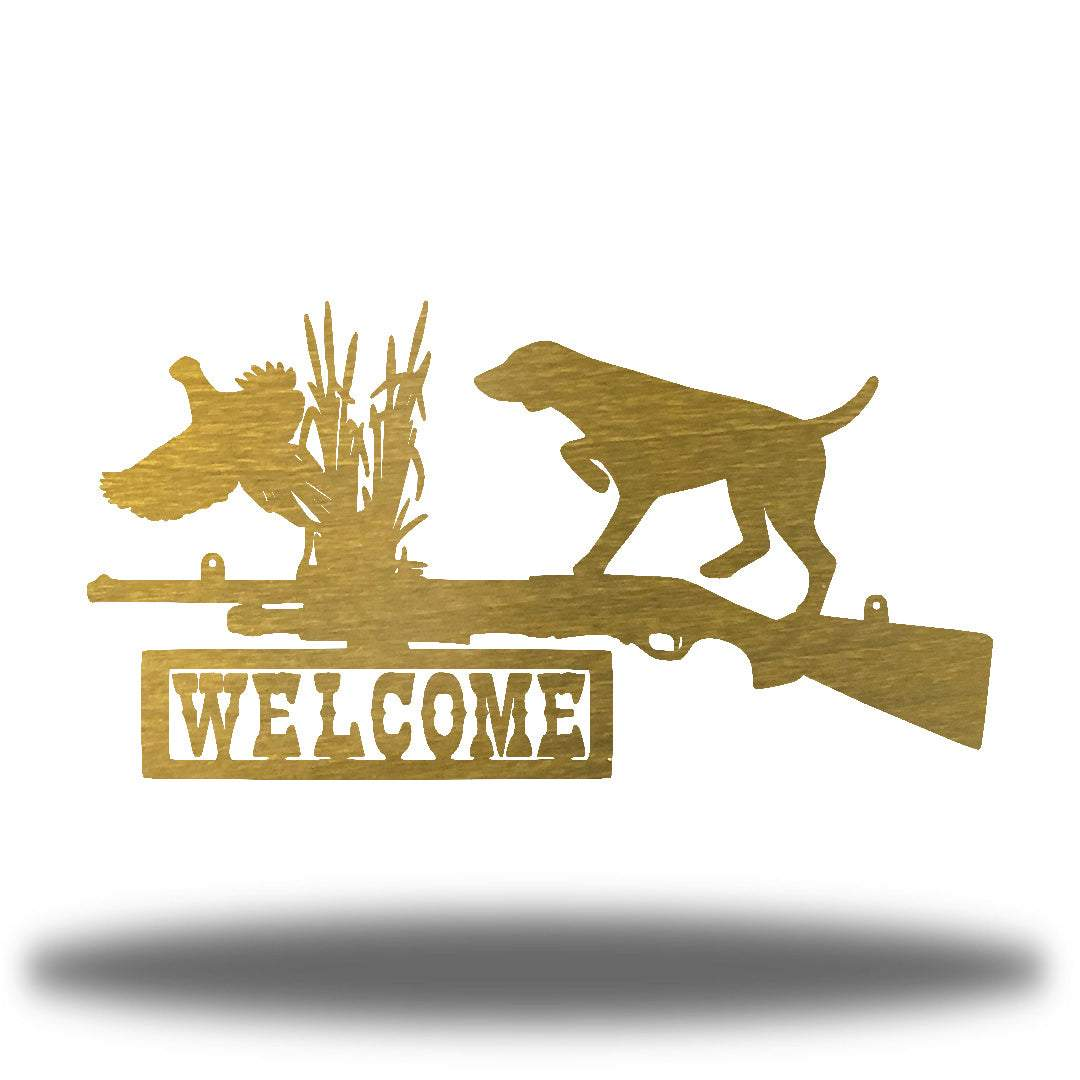 "Gold steel wall art decoration that features a dog, duck and shotgun with the word ""WELCOME"" on it"