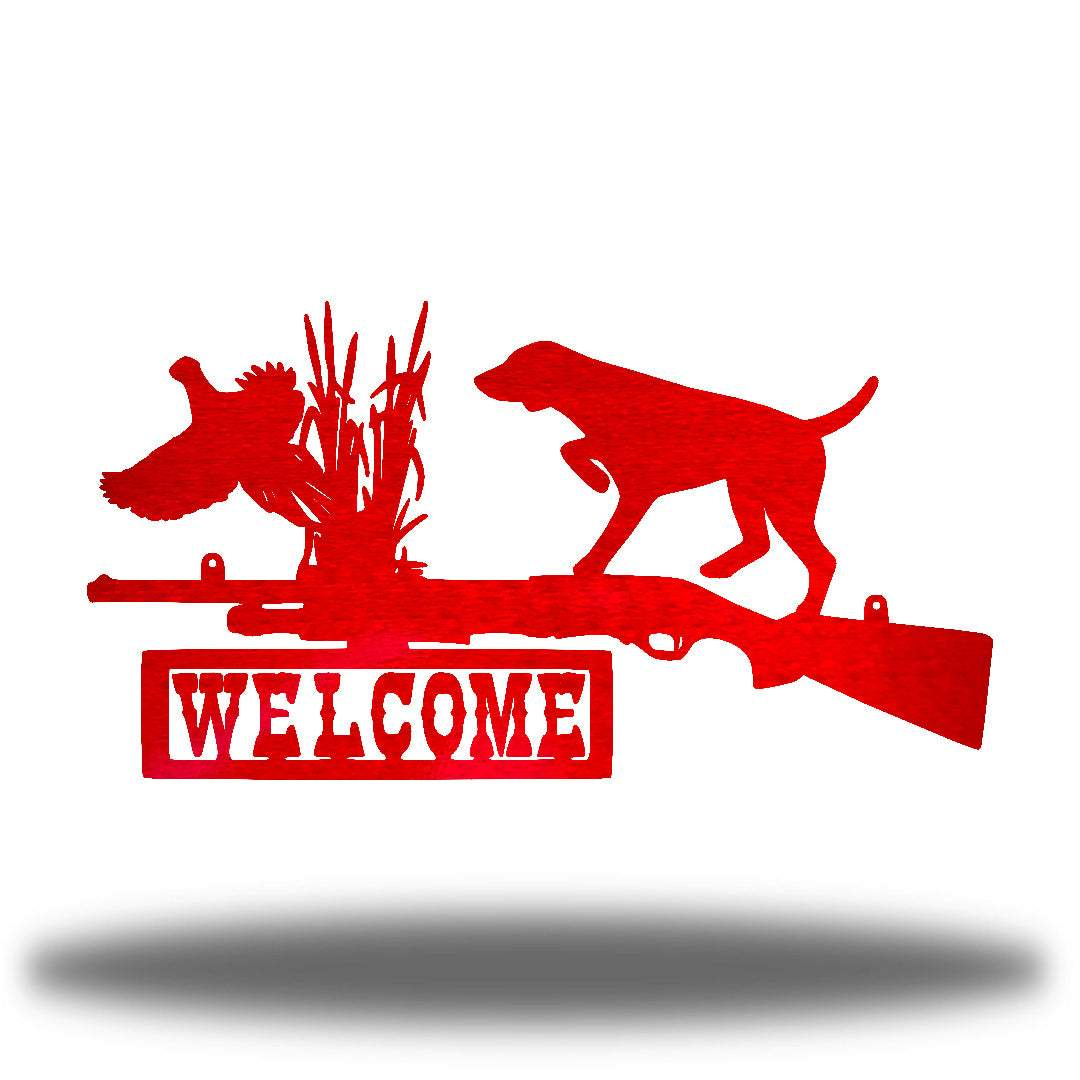 "Red steel wall art decoration that features a dog, duck and shotgun with the word ""WELCOME"" on it"