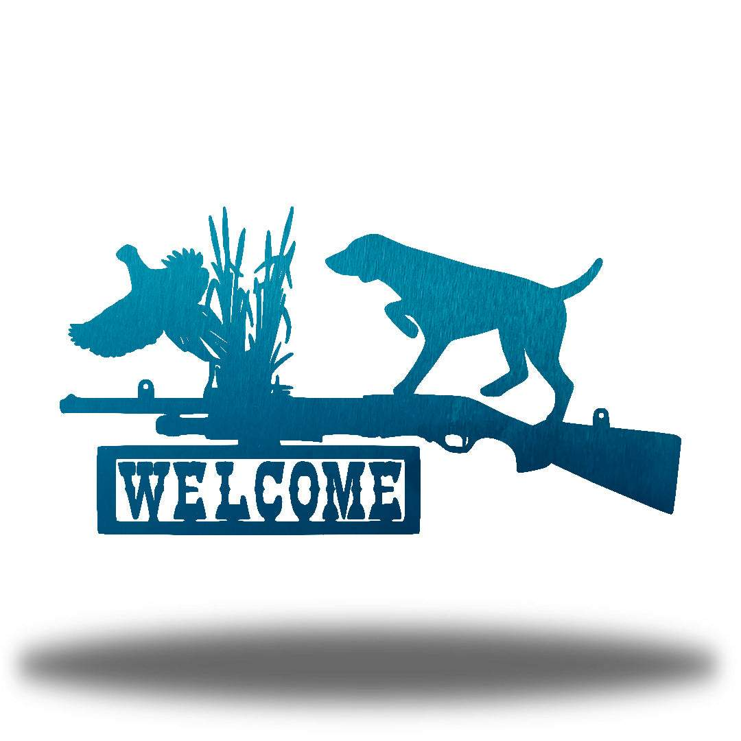 "Teal steel wall art decoration that features a dog, duck and shotgun with the word ""WELCOME"" on it"