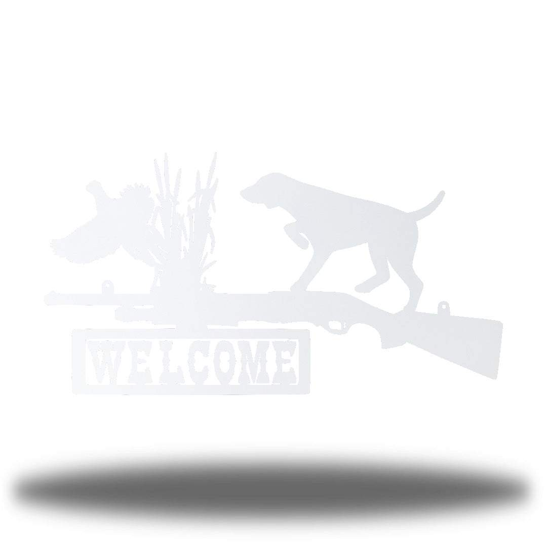 "White steel wall art decoration that features a dog, duck and shotgun with the word ""WELCOME"" on it"