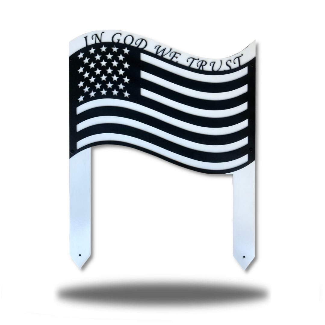 "Black US flag steel garden stake decoration with the texts ""IN GOD WE TRUST"" above it"