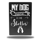 "Black wall decoration signage has a basset hound and texts ""MY DOG found me AT THE Shelter"" on it"