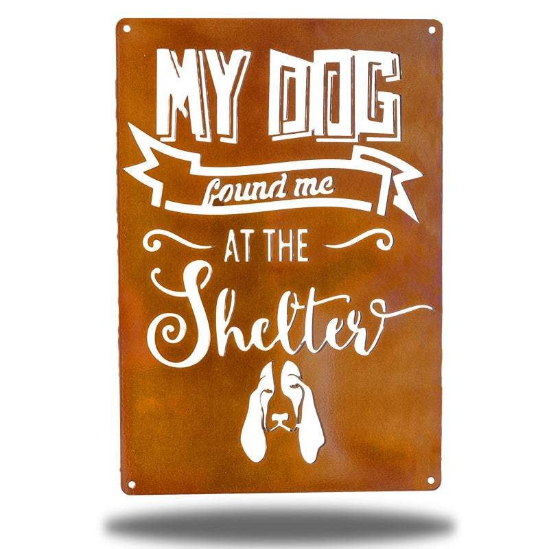 "Copper wall decoration signage has a basset hound and texts ""MY DOG found me AT THE Shelter"" on it"