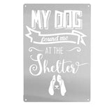 "Silver wall decoration signage has a basset hound and texts ""MY DOG found me AT THE Shelter"" on it"