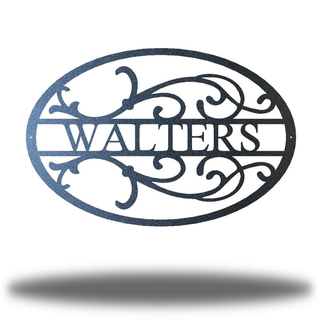 "Black oval-shaped steel monogram with the name ""WALTERS"" on it"