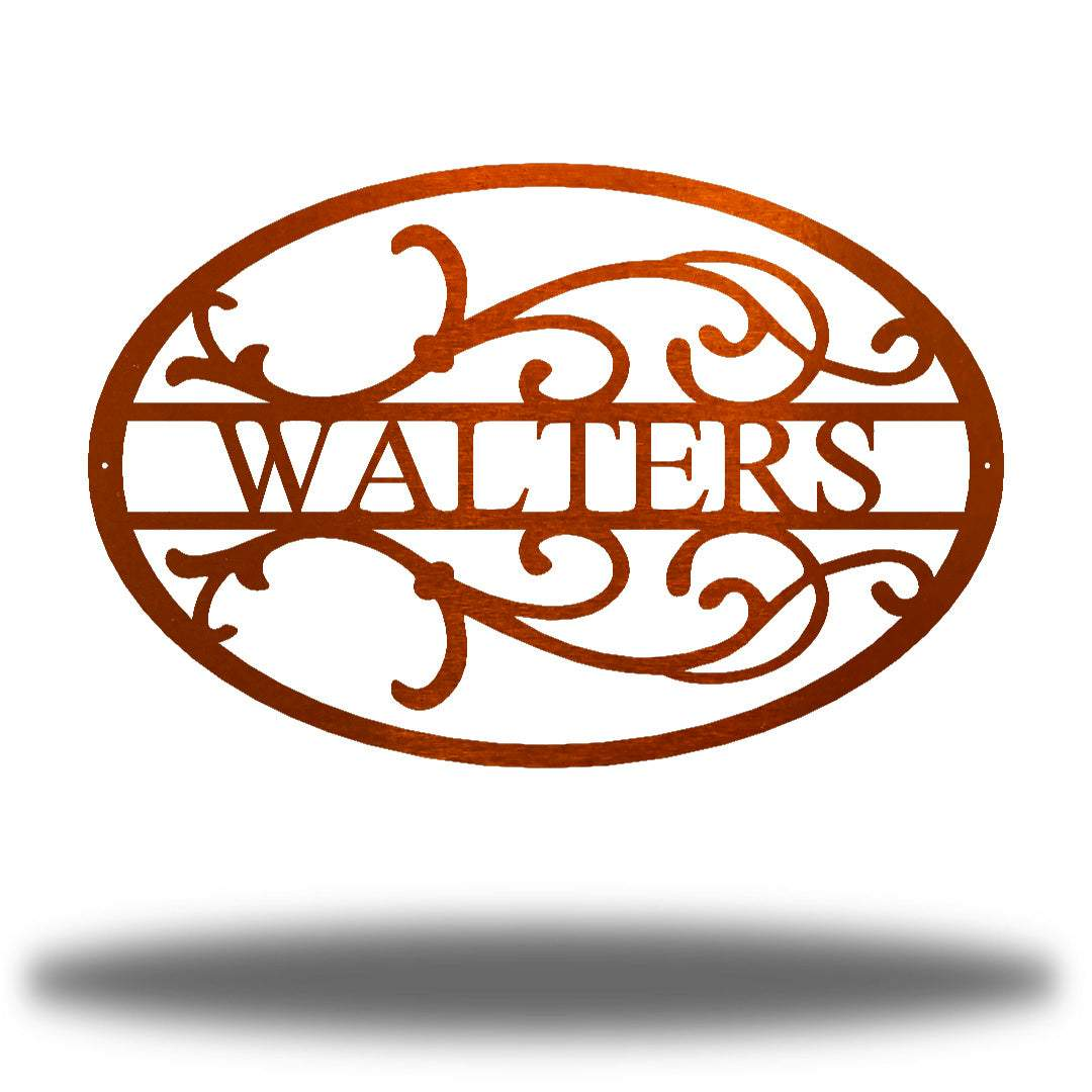 "Copper oval-shaped steel monogram with the name ""WALTERS"" on it"