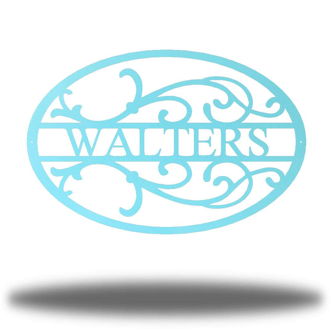 "Light blue oval-shaped steel monogram with the name ""WALTERS"" on it"