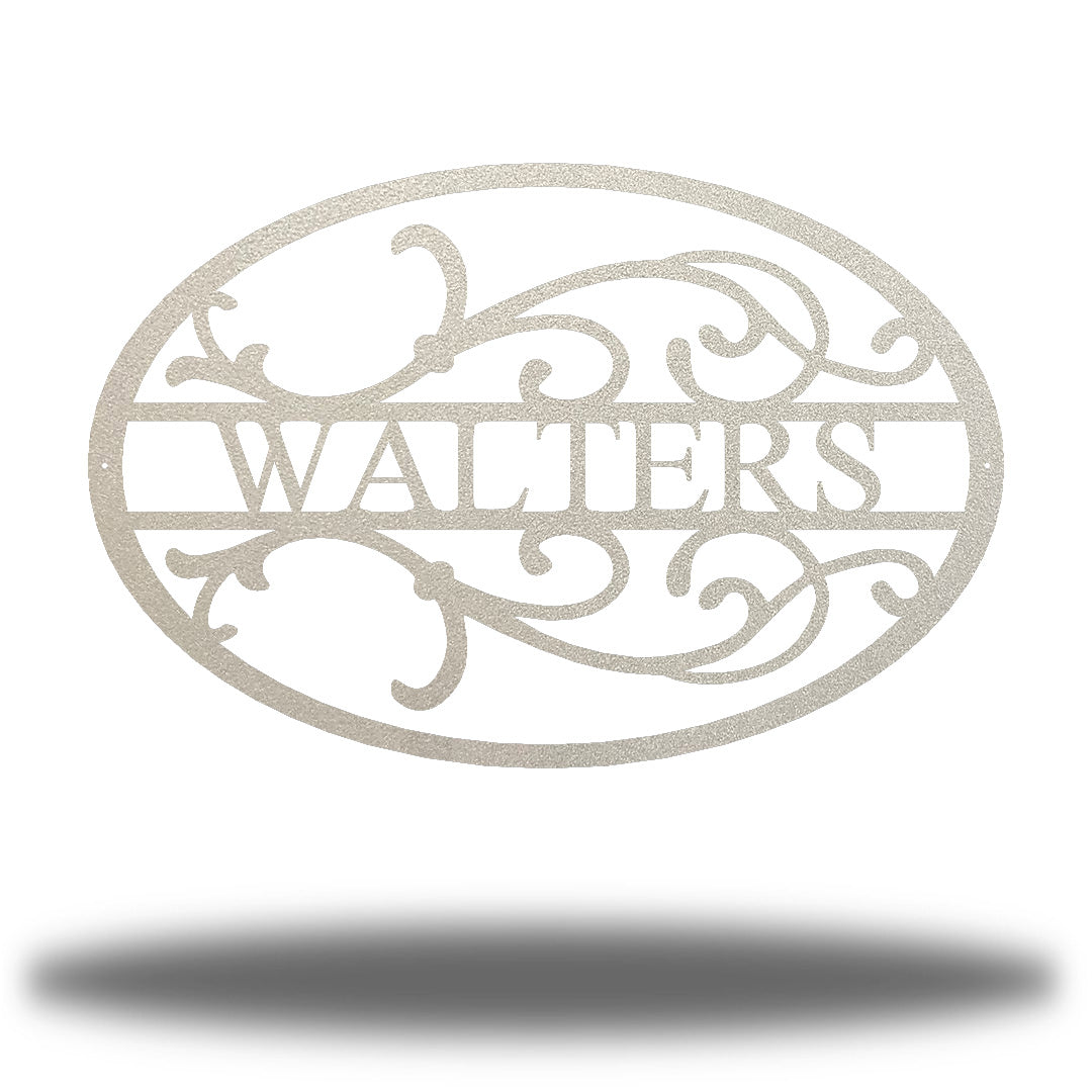 "Silver oval-shaped steel monogram with the name ""WALTERS"" on it"