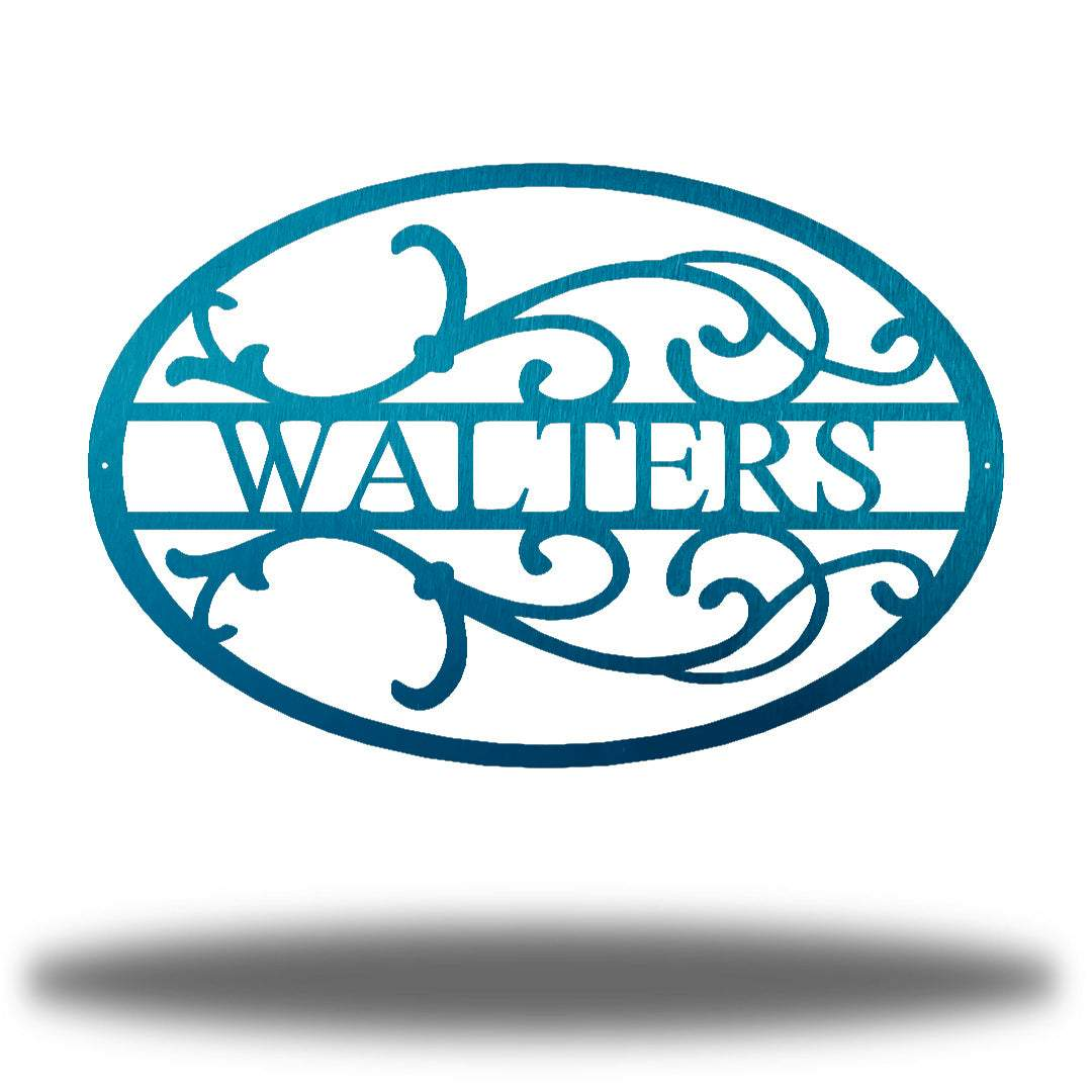 "Teal oval-shaped steel monogram with the name ""WALTERS"" on it"