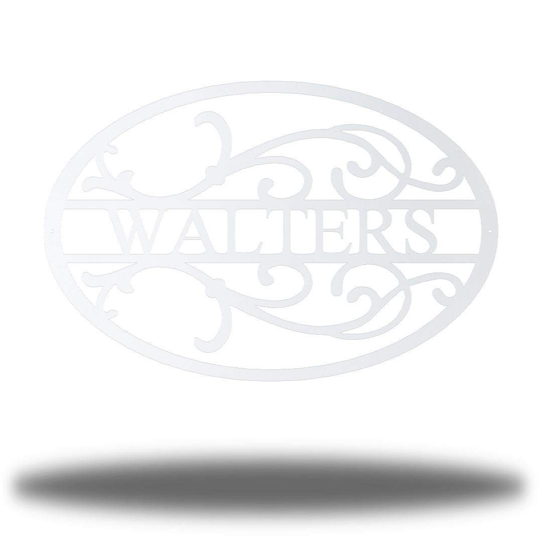 "White oval-shaped steel monogram with the name ""WALTERS"" on it"
