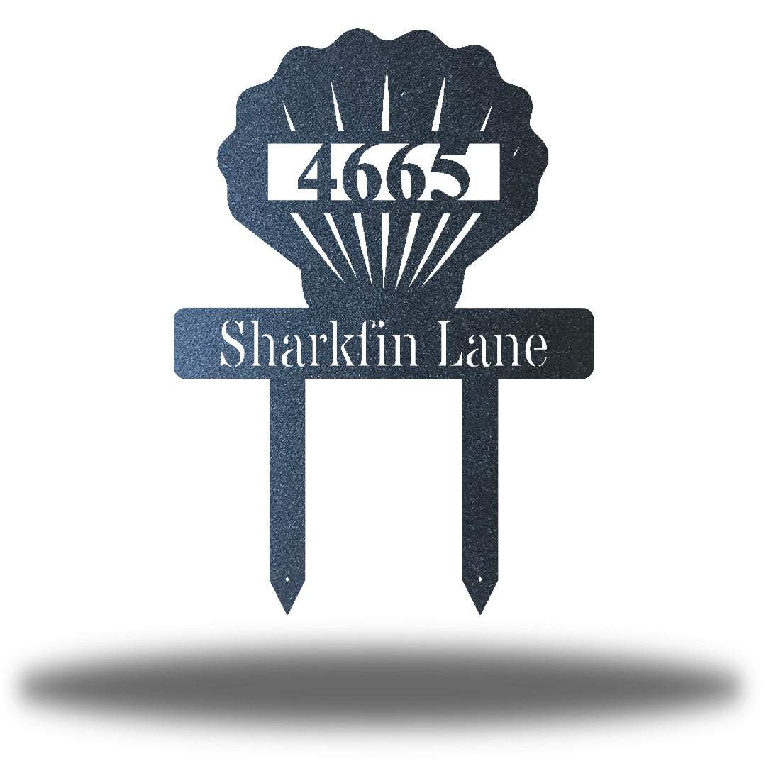 "Black scallop-shaped yard stake address sign with the texts ""4665 Sharkfin Lane"""