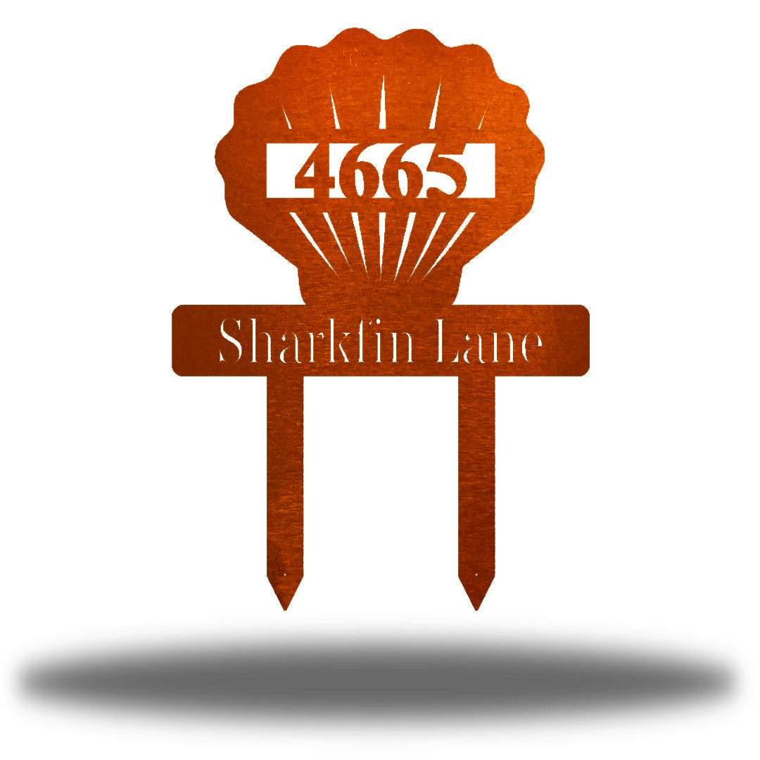 "Copper scallop-shaped yard stake address sign with the texts ""4665 Sharkfin Lane"""