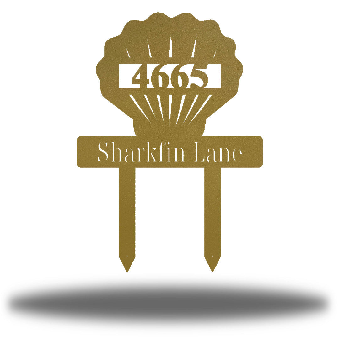 "Gold scallop-shaped yard stake address sign with the texts ""4665 Sharkfin Lane"""