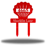 "Red scallop-shaped yard stake address sign with the texts ""4665 Sharkfin Lane"""